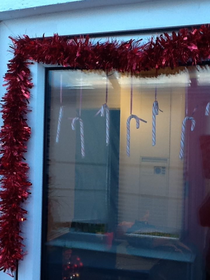 Christmas decorations on a budget for the kitchen window.