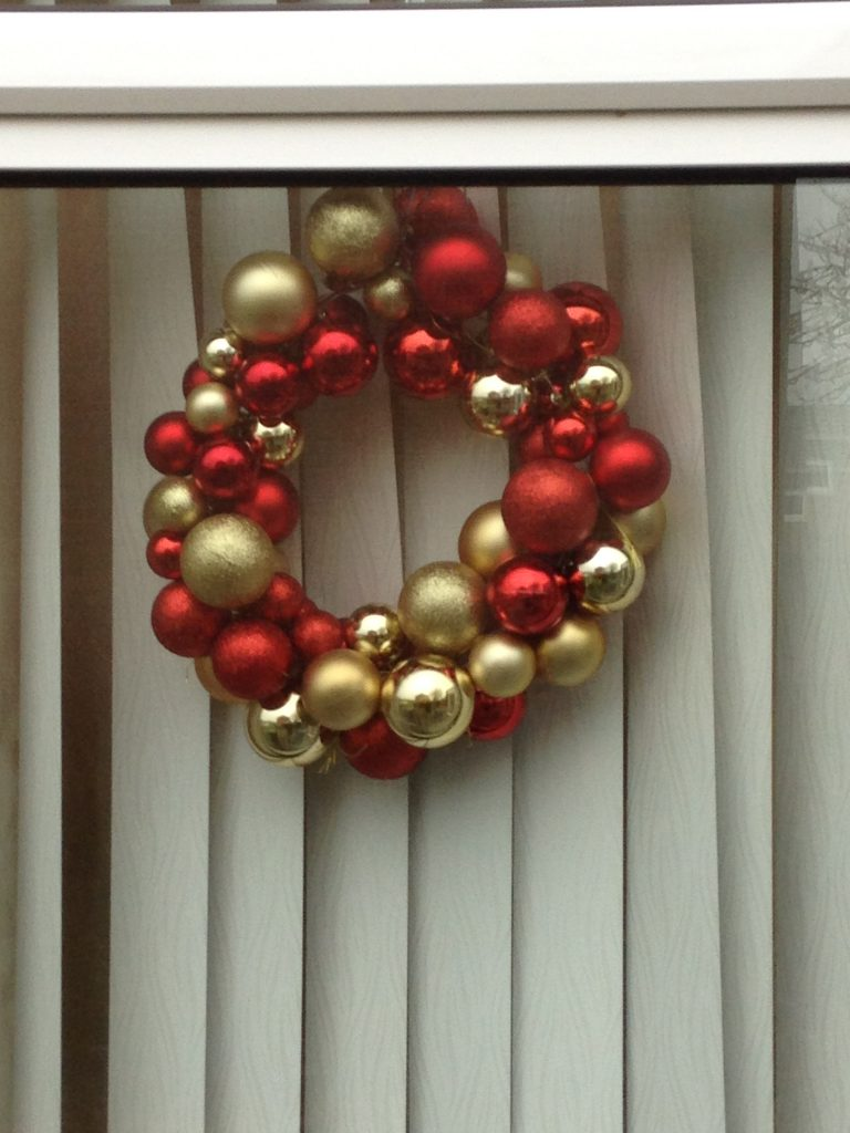 Make Christmas decorations on a budget using baubles and a wire hanger.