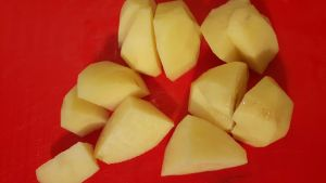 Peel your growing potatoes and cut them into wedges for a potato salad or spicy wedges.