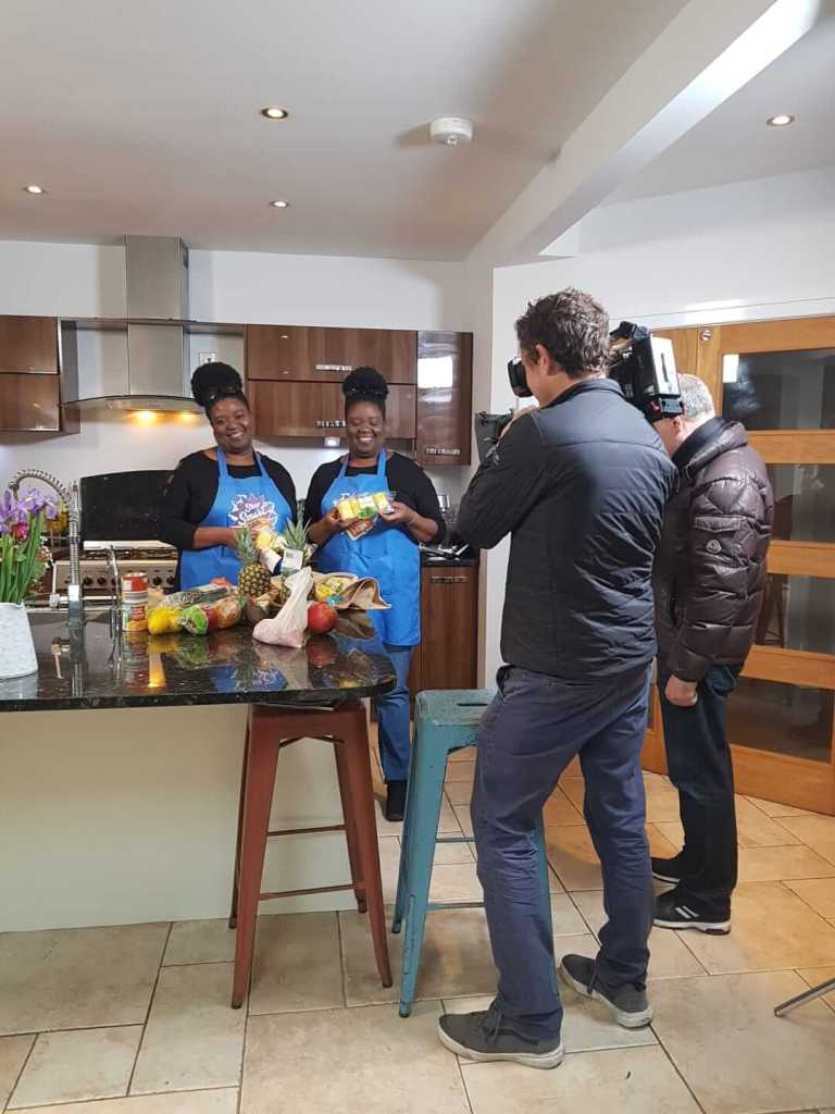 Photo shows twins joleisa being filmed on the day of the BBQ for Shop Smart Save Money