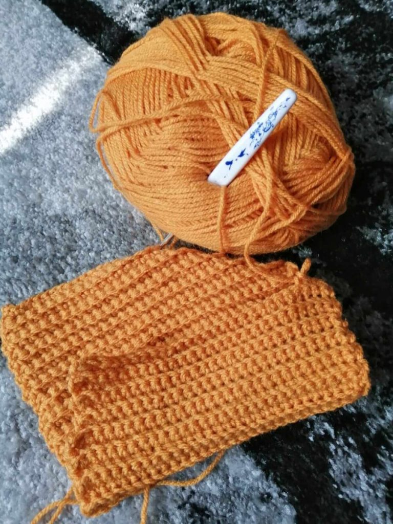 A picture of making a crochet pumpkin as part of a crafts for Fall series.