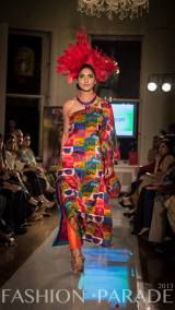 Fashion Parade event, supporting Save The Children charity. A catwalk with Nomi Ansari design and Madeira statement necklace by Jolita Jewellery.