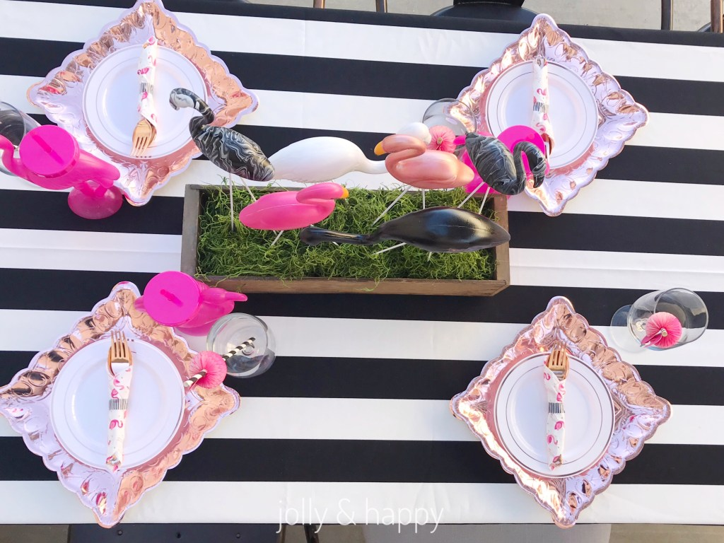 rose gold place settings with black and white tablecloth
