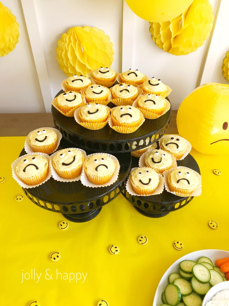 happy and sad yellow cupcakes