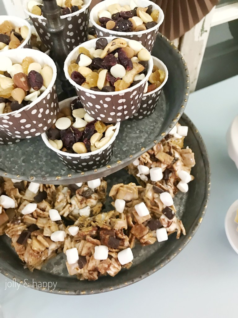 cups of trail mix and s'mores bars for camping themed baby shower