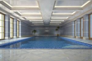 Indoor swimming pool by Jolyon Way, stone floor, painted woodwork