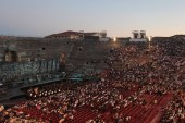 The audience fills the Verona Arena, as the sun goes down.