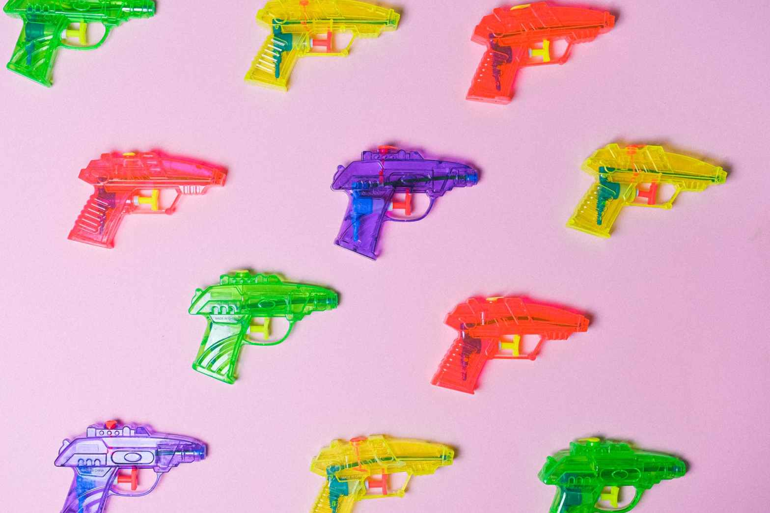 assortment of colorful guns for game