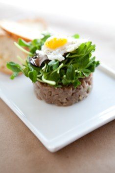 Lamb Tartare with Black Truffle and Pea Shoots Topped with a Quail Egg
