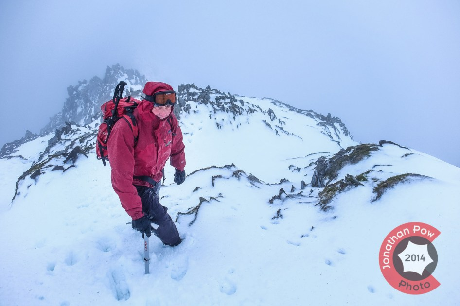 Graham poses for a photo, out of the rain, near the summit.