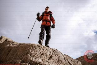 Commercial Photography Sports - A model climbing in a down jacket