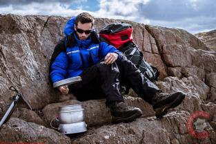 Commercial Photography Sports - A model on a crag boiling a cup of tea
