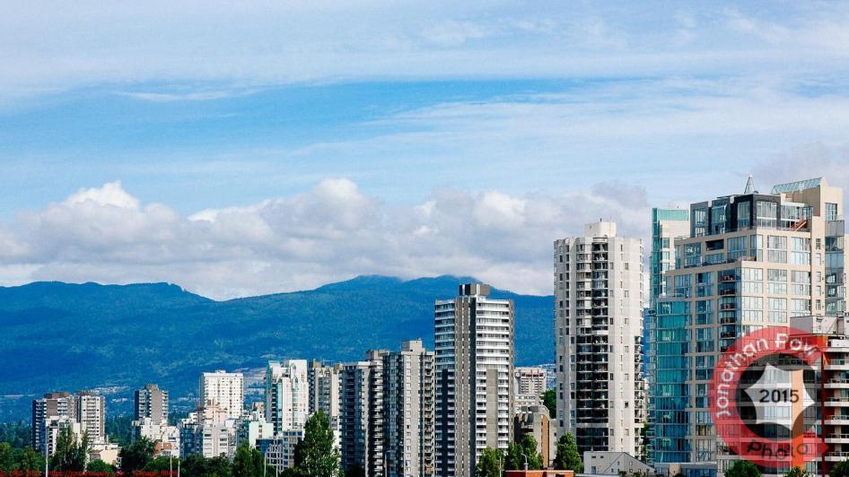 Vancouver skyline along English Bay looking toward Cypress Park & Mountain