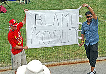 220px-Blame_Mosley_banner