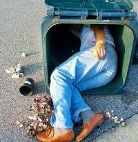 larry wilder asleep in trash can