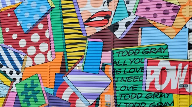 colorful pop art style graphics painted on a wall