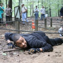 Namir Branch, an intern with the U.S. Army Test and Evaluation Command, takes part in an obstacle course during Aberdeen Proving Ground's annual greening course.