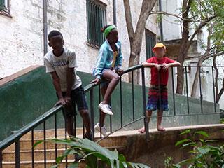 Three children on steps in Cuba