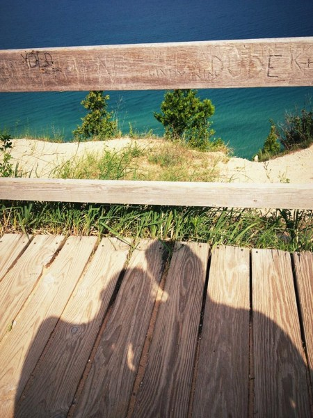 shadow of Abby and Christopher overlooking Lake Michigan