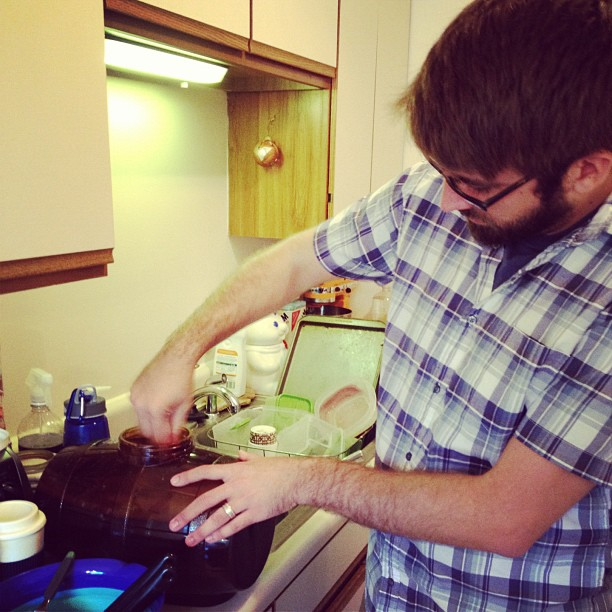 Christopher mixing up home brew beer