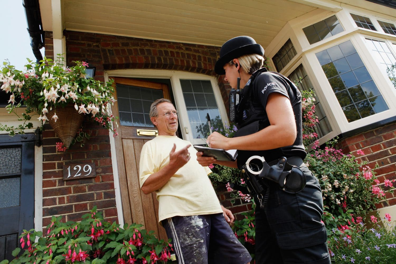 Police Officer with a resident conducting door to door enquiries