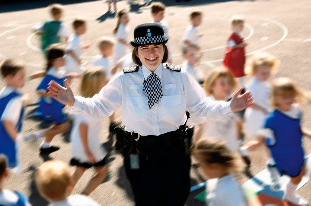Police Officer with Surrey school children