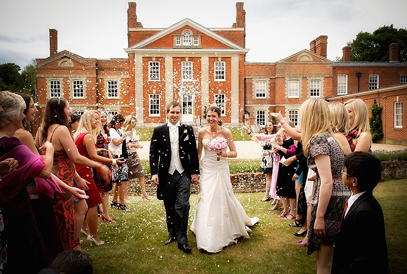 Shower of Confetti in front of Warbrook House, Eversley, wedding day
