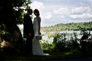 Silhouetted Bride and Groom at Frensham Pond