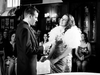 Laughter duing the wedding vows at Loseley Park