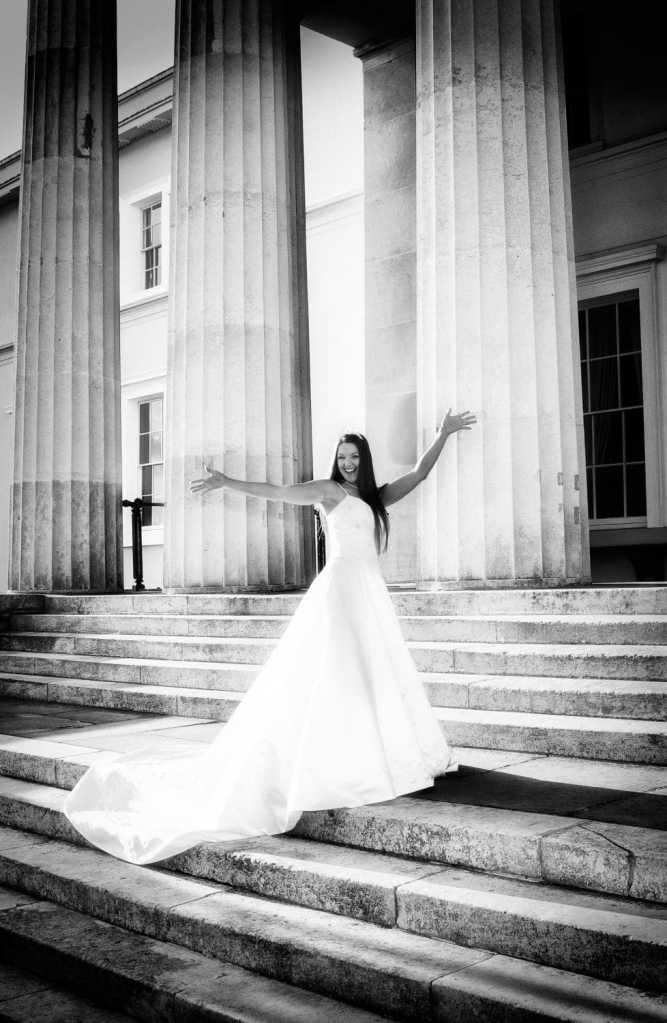 Fun bride on the steps of the Royal Military Academy Sandhurst