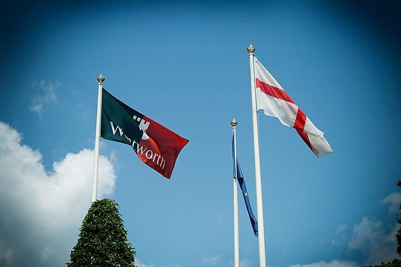 Wentworth Club flags, blue sky wedding