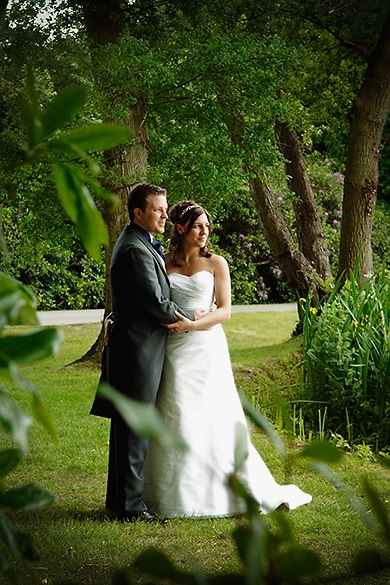 beside the lake, bride and groom