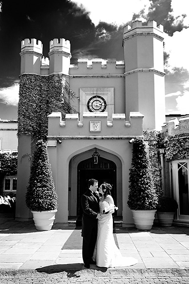 Couple outside the castellated clubhouse at Wentworth Club