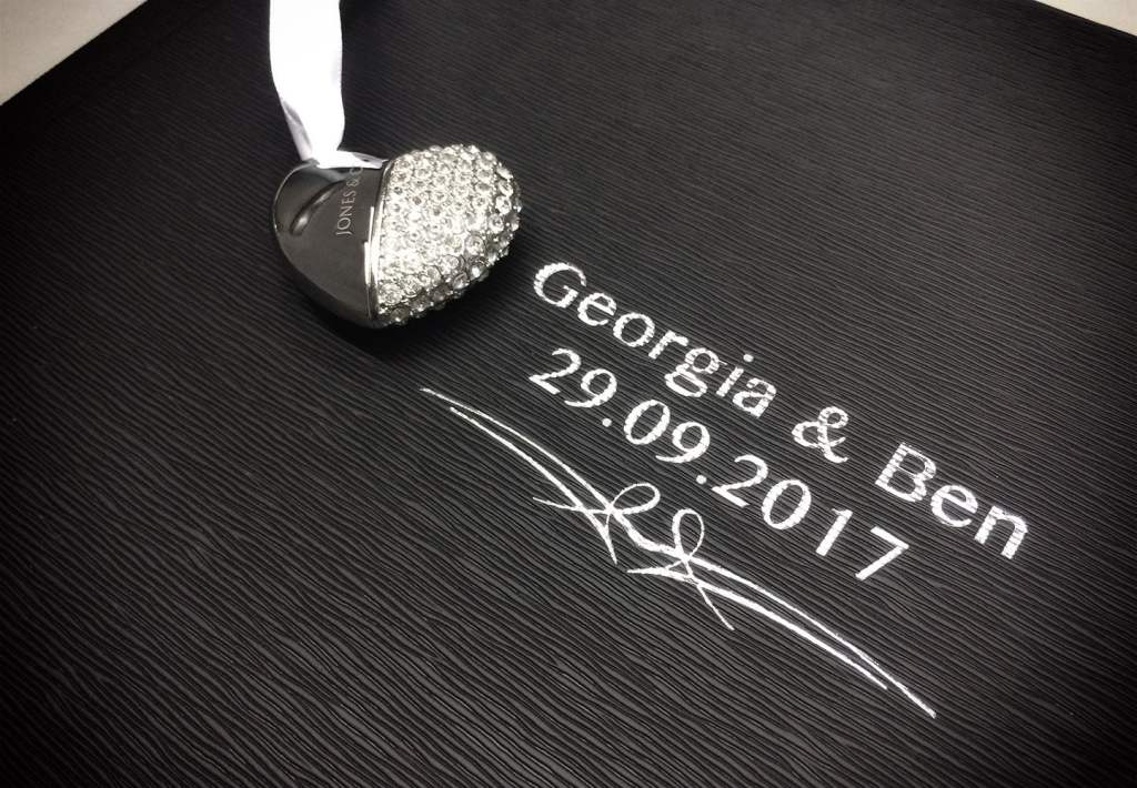 Textured album cover with silver blocking of the couples names and wedding date.