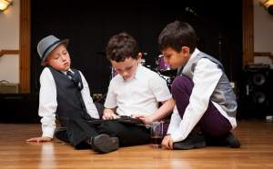 Children at a wedding reception, sitting on the floor