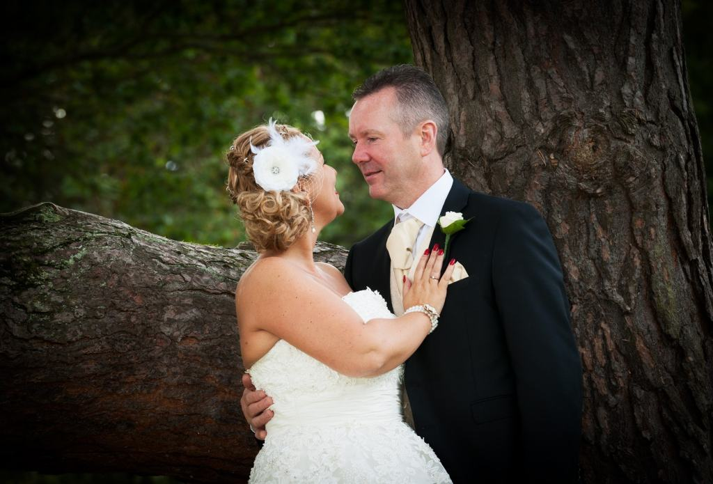 Vintage woodland wedding, bride and groom under an oak tree