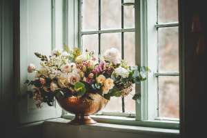 Bowl of wedding flowers in the window