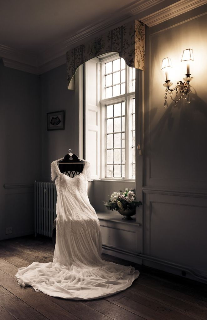 Vinatge Wedding Dress by a window in a country house