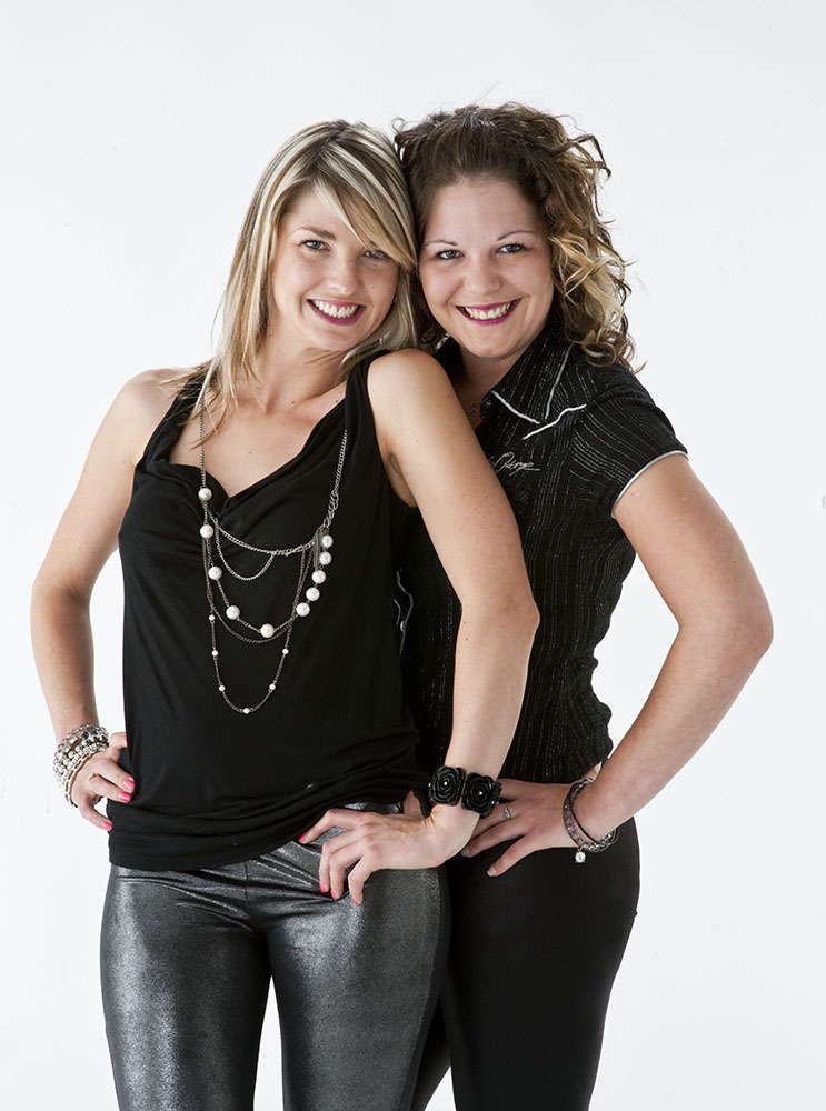 Studio portrait of two sisters in their 20s