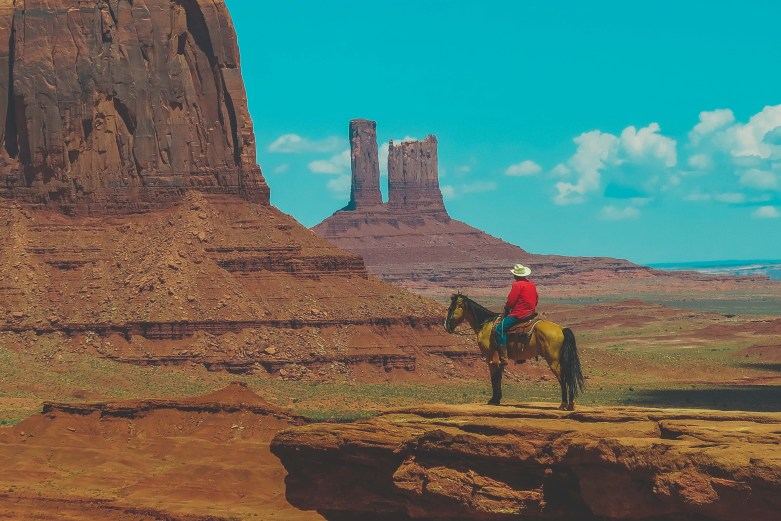 monument valley cowboy on the ridge