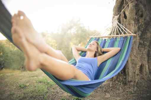 woman-in-blue-tank-top-lying-on-hammock-3771799