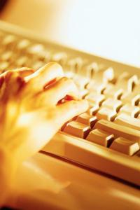 hands shown on computer keyboard