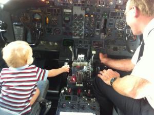 boy in cockpit of commercial jet
