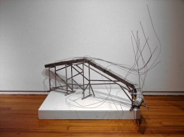 Untitled (caterpillar), 2009. Wood and ink/alcohol, cast concrete, steel wire and paint. 44 x 48 x 27""