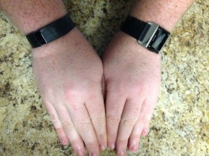 Wearing two fitness trackers at once, the 2014 Carbon Steel Basis on my left wrist, the Fitbit Force on my right.