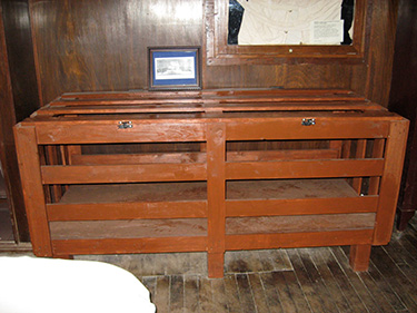 "An ""Utica crib"" used for the transport and restraint of patients."