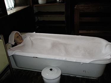 """A bath used to """"calm"""" patients by restraining them in a bath of cold or warm water for hours on end."""