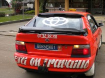 """2.- Another testament to work – this taxi's bumper reads """"Here one works."""""""