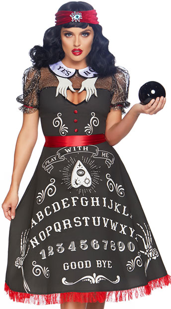 "A woman in a long black dress with letters formatted like a ouija board, labeled ""play with me"""