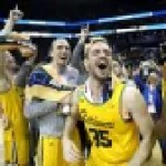 The UMBC Retrievers celebrate after winning the first 16-vs-1 matchup in NCAA men's basketball tournament history